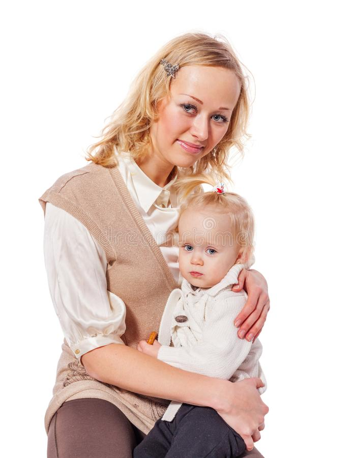 Mother holding daughter stock photography