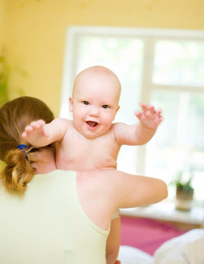 Mother holding enjoying baby