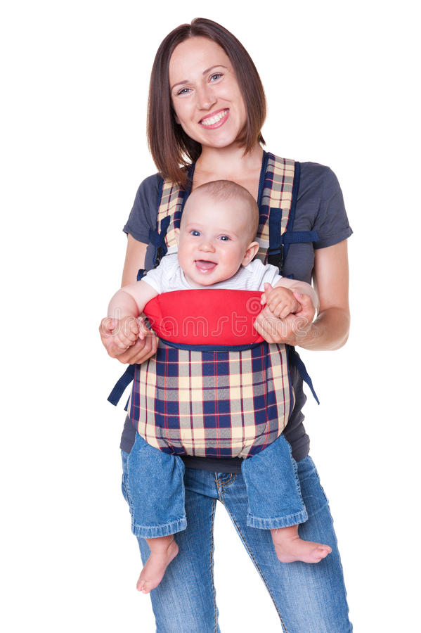 Mother holding her baby in the knapsack. Happy mother holding her baby in the knapsack. isolated on white background royalty free stock photos