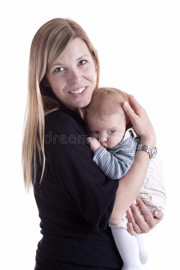 Mother holding her baby with tenderness stock photo