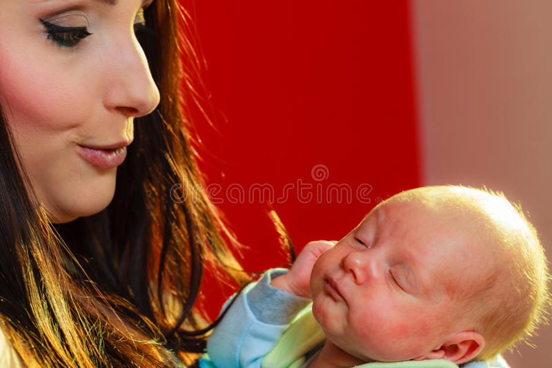Download Mother Holding Her Little Newborn Baby Stock Photo - Image: 83710272