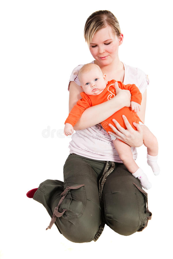 Mother Holding Holding Her Baby stock images