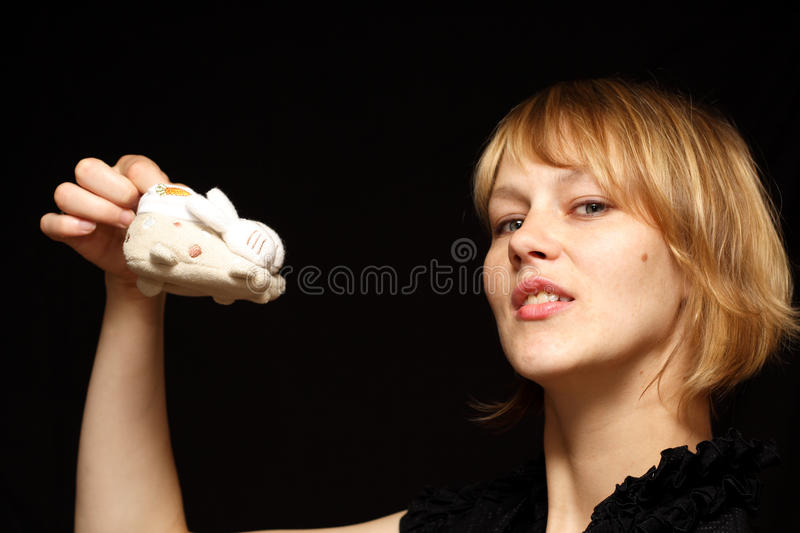 Mother holding little baby shoes royalty free stock photos