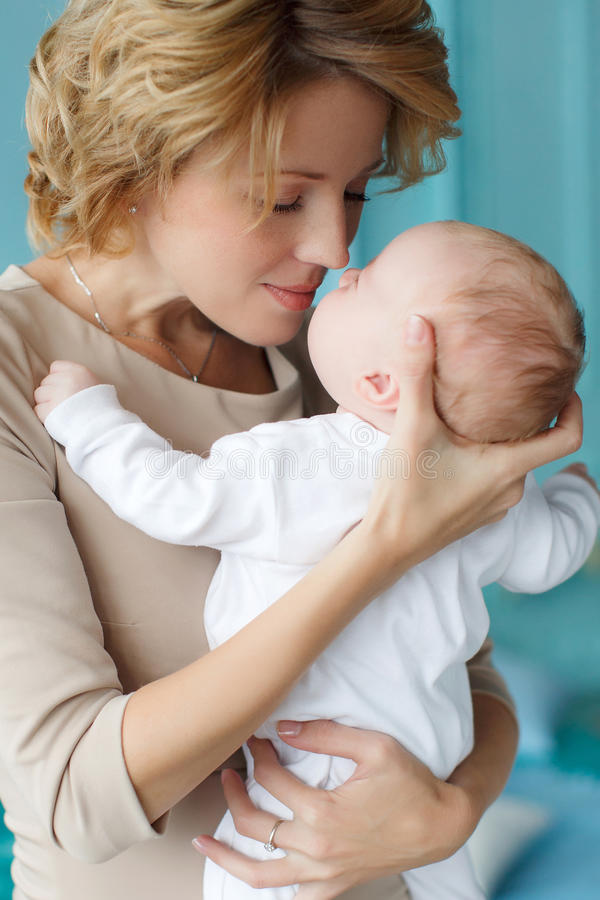 Download mother holding a newborn baby in her arms stock photo image of childhood