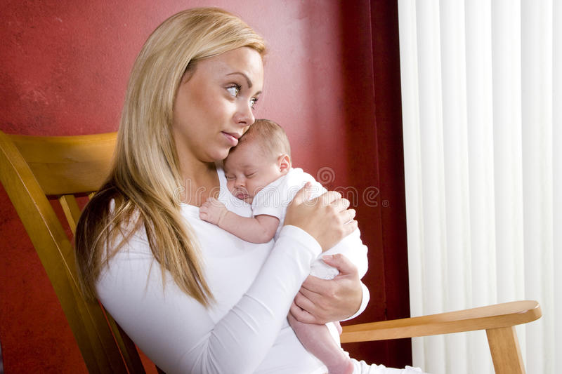 Download Mother Holding Newborn Baby In Rocking Chair Stock Image - Image of child, blond: 13329897