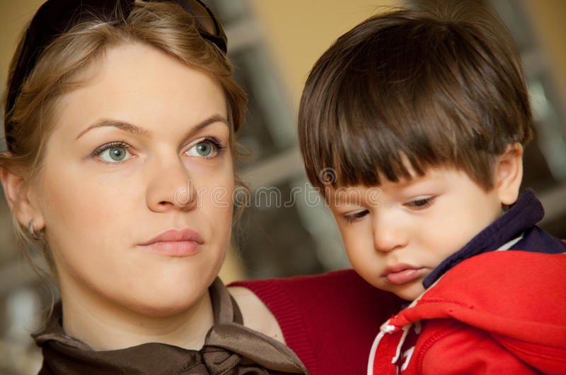 Mother holding son stock photo