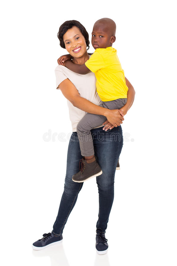 Mother holding son. Loving young african mother holding her son on white background royalty free stock images