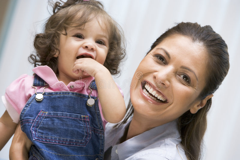 Download Mother holding young girl stock image. Image of horizontal - 5004567