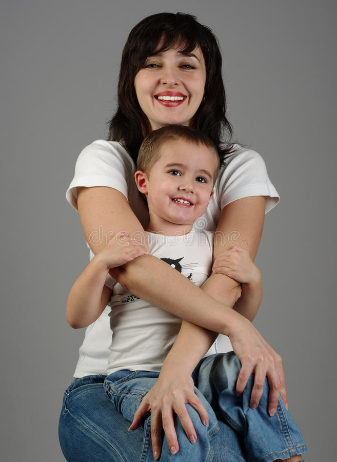 Mother holds her son in her arms royalty free stock photos