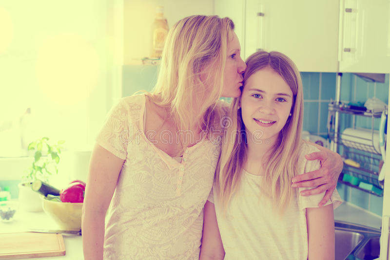 Mother hugged her daughter stock photos
