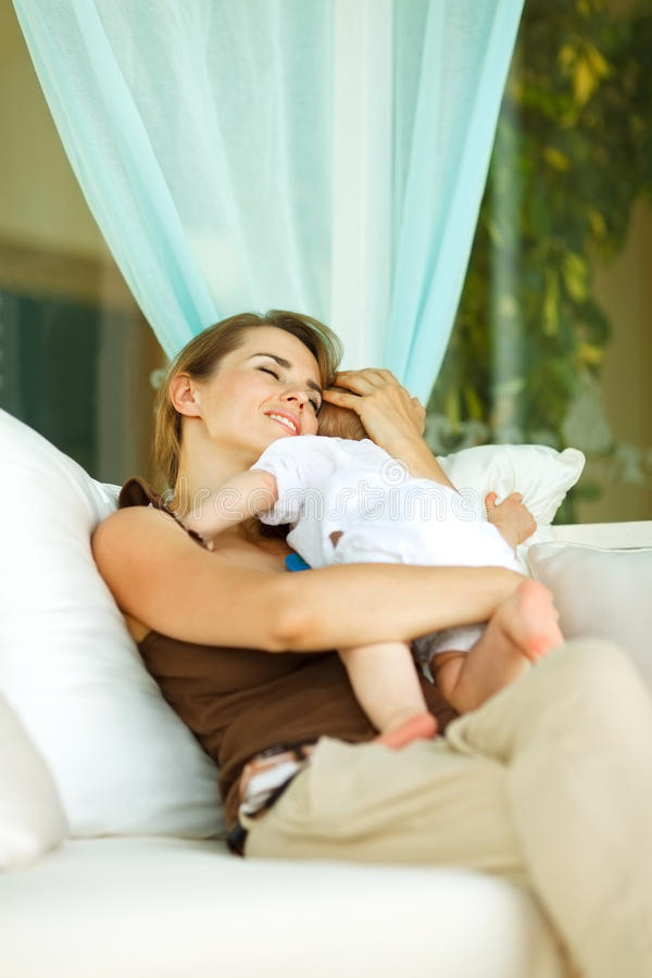 Download Mother Hugging Baby At Terrace Stock Photo - Image: 23648166