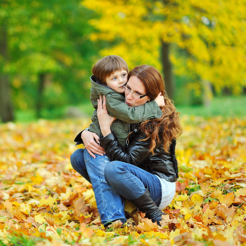 Mother hugging child - outdoor portrait royalty free stock image