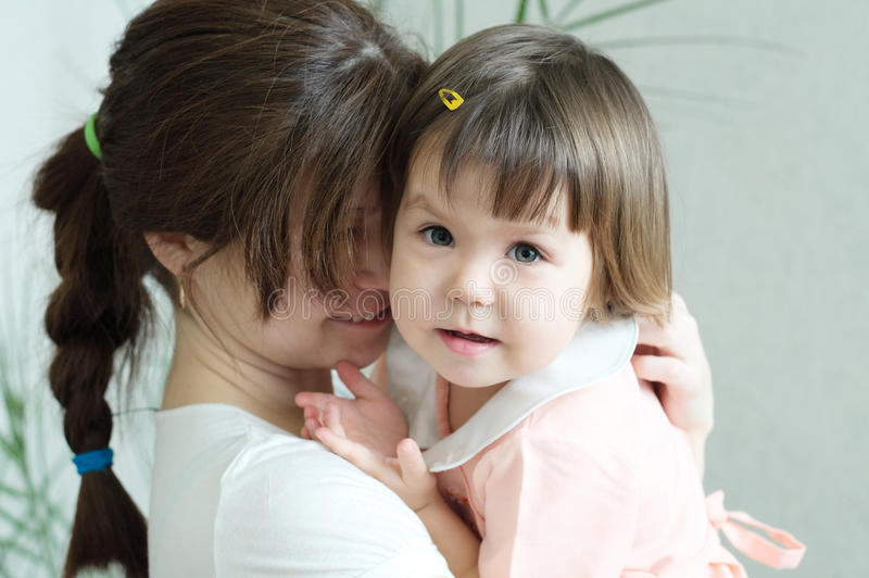 Mother hugging child, physical contact, family relationships, cuddling baby for physical affection, communicate happy daughter. Happy childhood for little girl stock photography