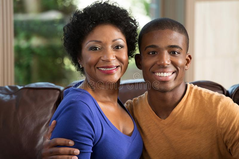 Mother hugging her adult son. stock photos
