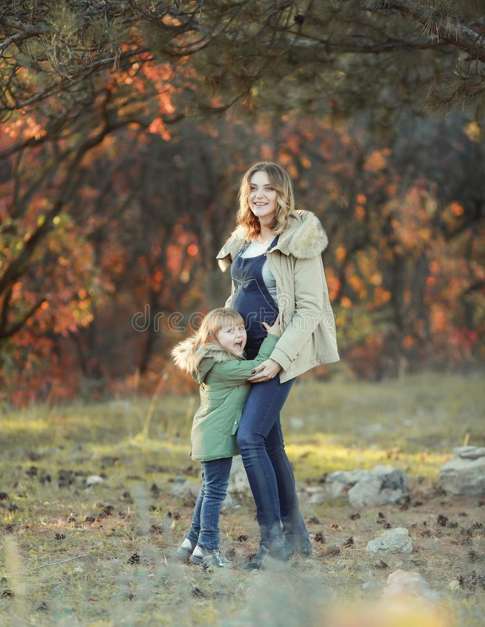 Mother hugging her child during walk in the park royalty free stock images