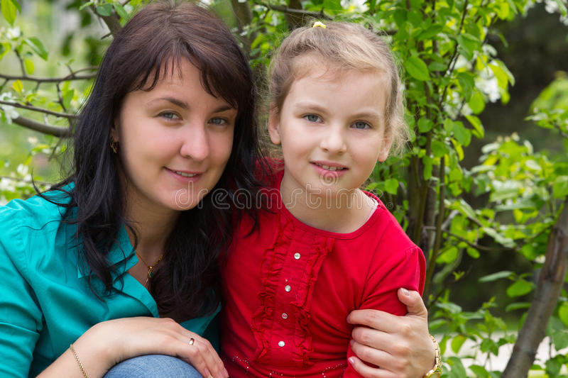Mother hugging her daughter royalty free stock image