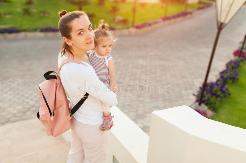 Mother hugging with her little daughter outdoor in nature on sunny day Positive human emotions, feelings, emotions stock images