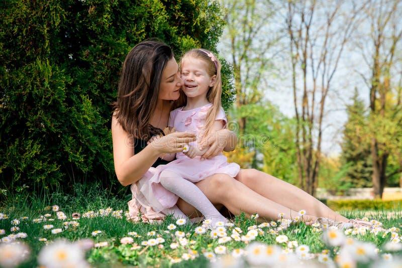 Mother hugging kid royalty free stock image