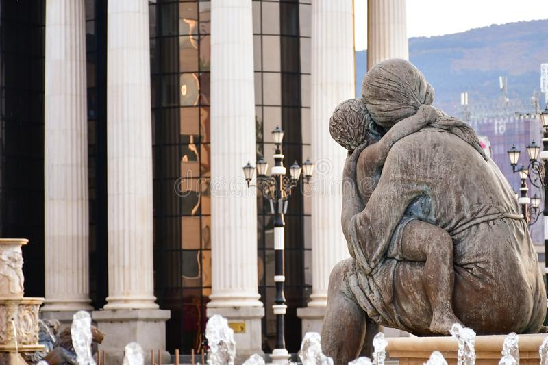 Mother hugging a child. Monument at the historical center of Skopje ,Macedonia royalty free stock photos