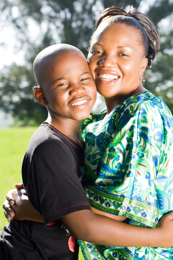 Mother hugging son stock photos