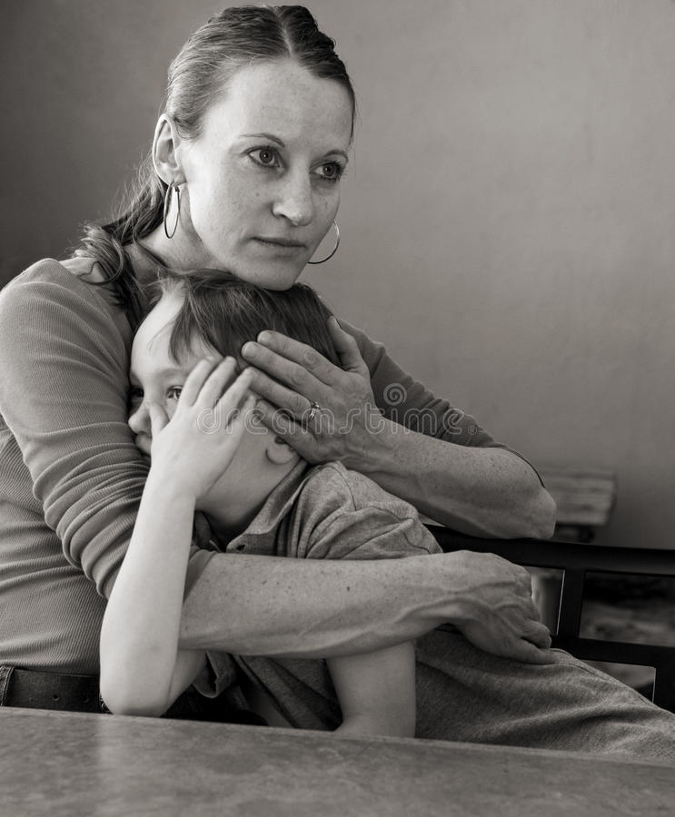 Download Mother hugs crying son stock image. Image of loving, hugging - 35117445