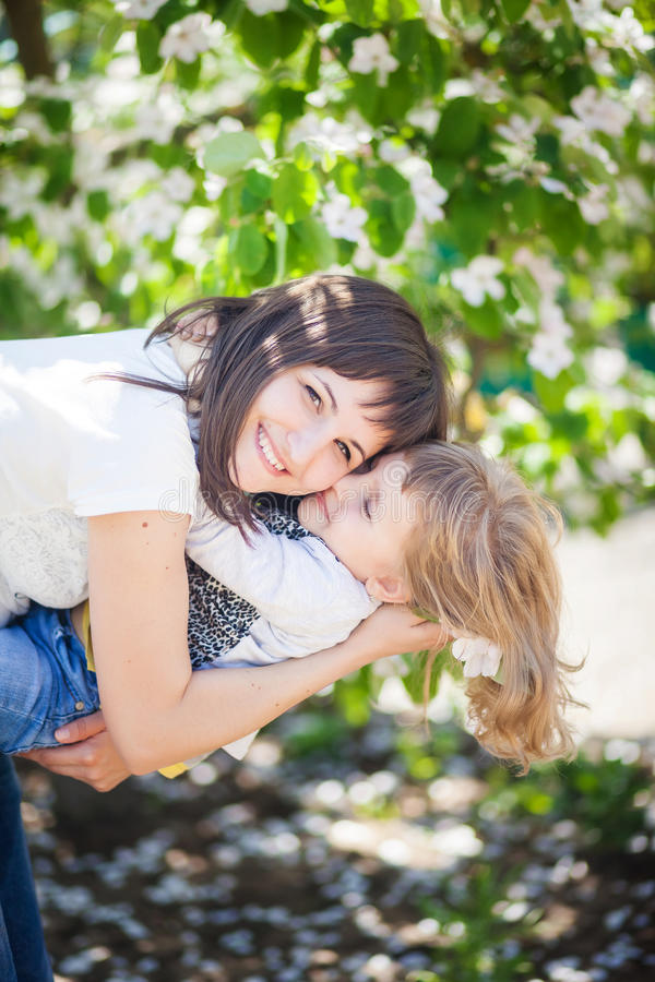 Mother hugs daughter royalty free stock photos