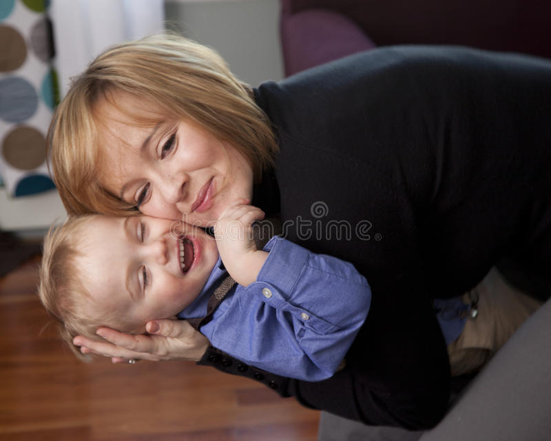 Mother Hugs Son Stock Photography