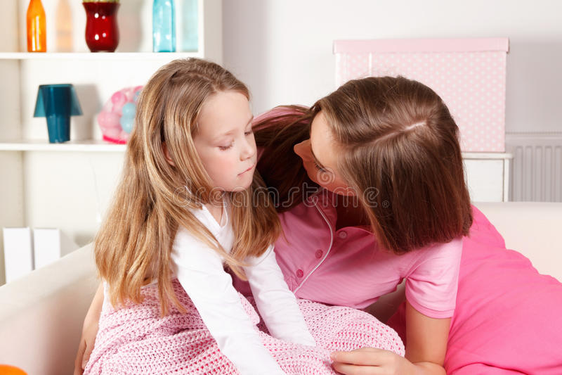Mother and ill child at home stock image