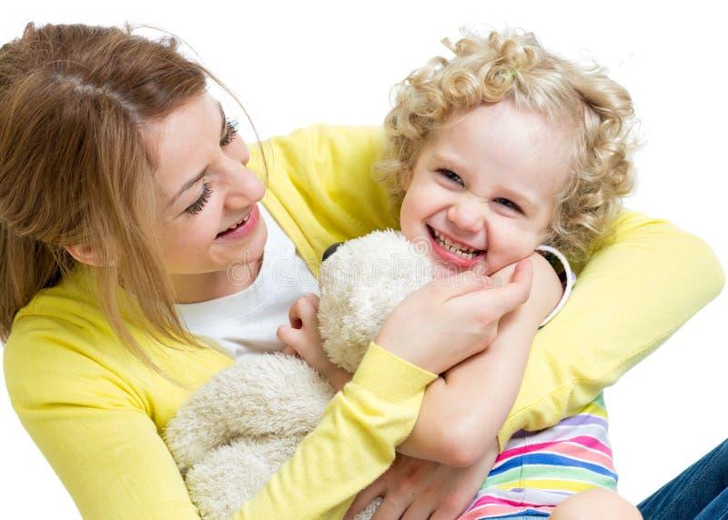 Mother and kid girl having fun stock photo