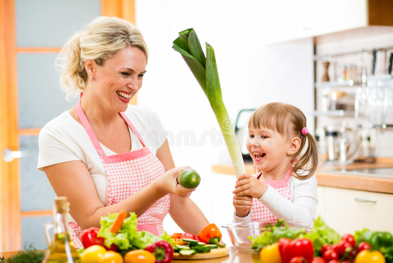 Mother and kid preparing food and having fun royalty free stock image