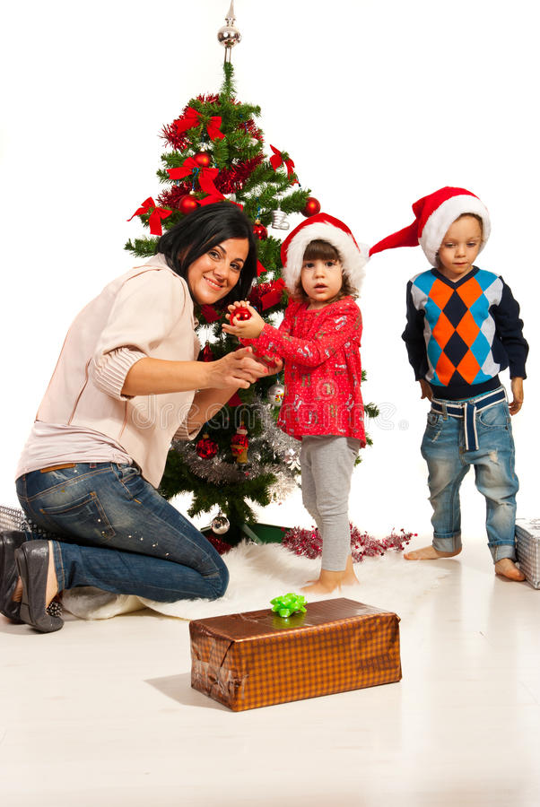 Download Mother With Kids Decorate Tree Stock Image - Image: 34640207