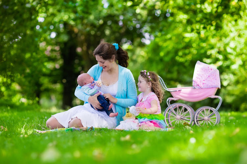 Mother and kids enjoying picnic outdoors stock image