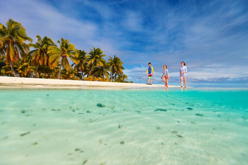 Family on a beach. Mother and kids family at tropical beach on Aitutaki island, Cook Islands, South Pacific stock photos