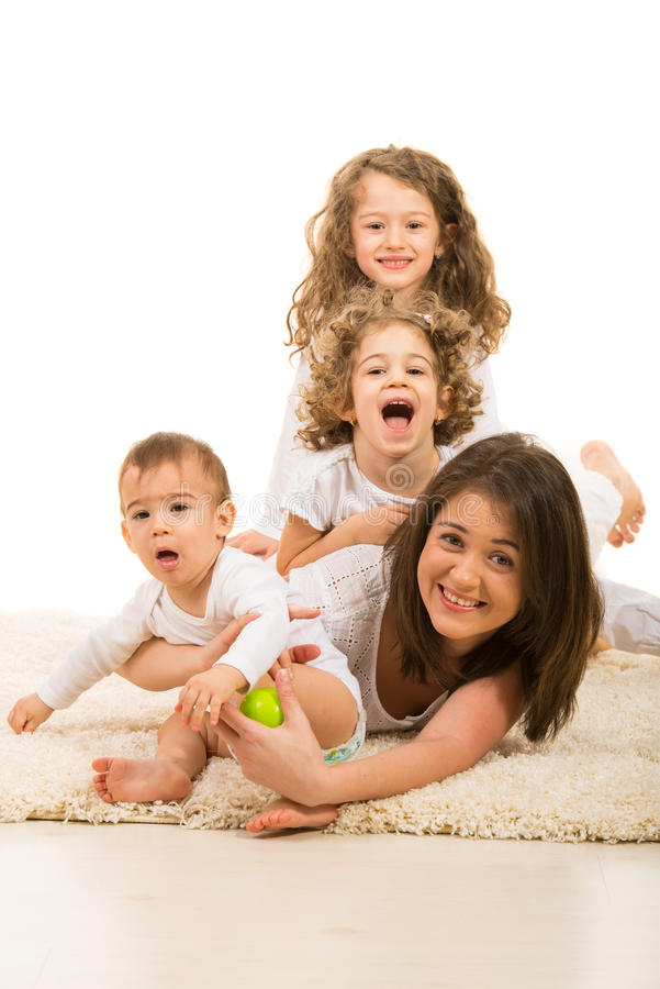 Mother and kids having fun home. Mother and their three kids having fun home royalty free stock images