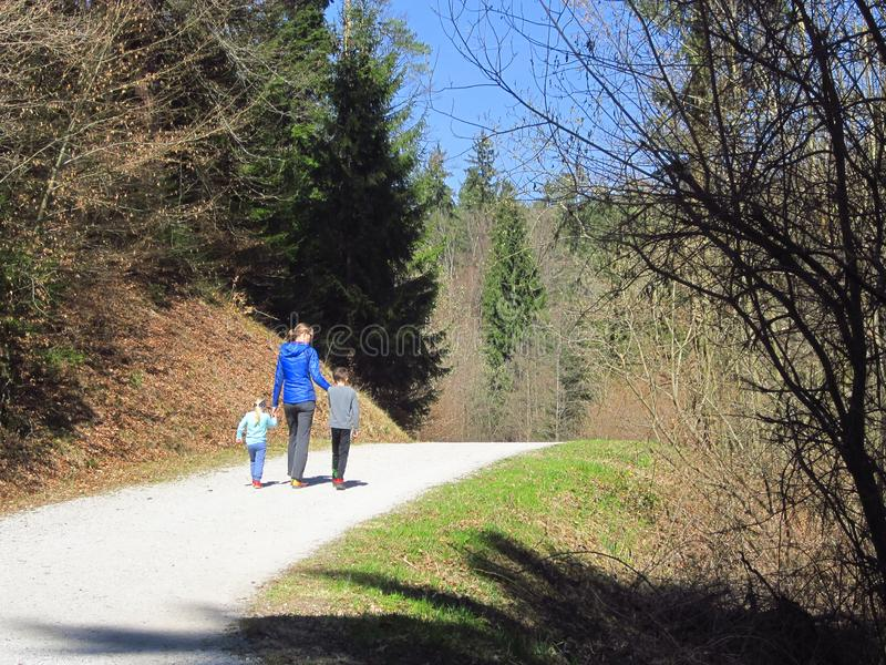 Mother with kids hiking in forest royalty free stock photography
