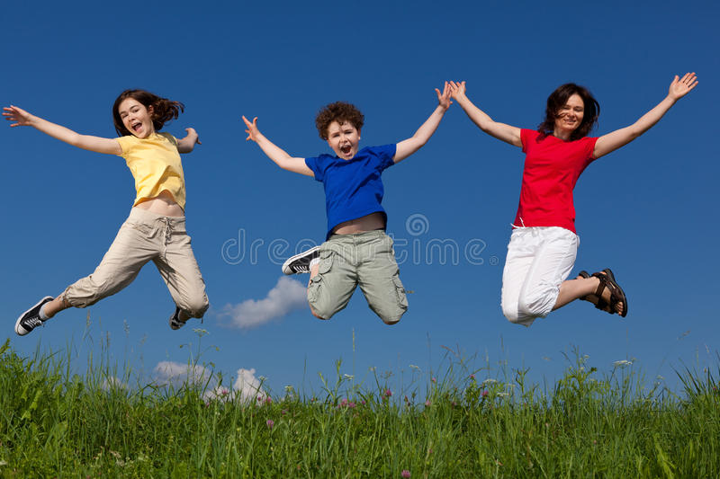 Mother with kids jumping stock photo