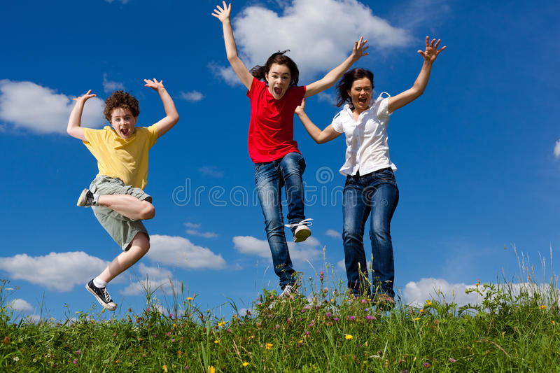 Download Mother with kids jumping stock photo. Image of green - 37353796