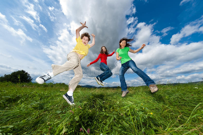 Download Mother With Kids Jumping Outdoor Stock Photo - Image: 23720346