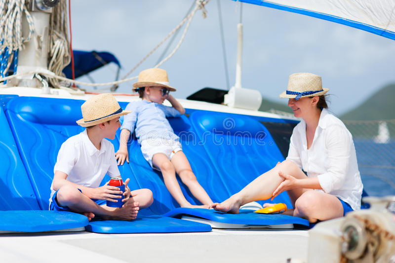 Mother and kids at luxury yacht royalty free stock images