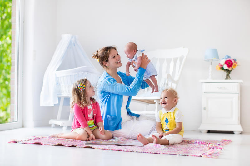 Mother and kids playing in bedroom stock photo