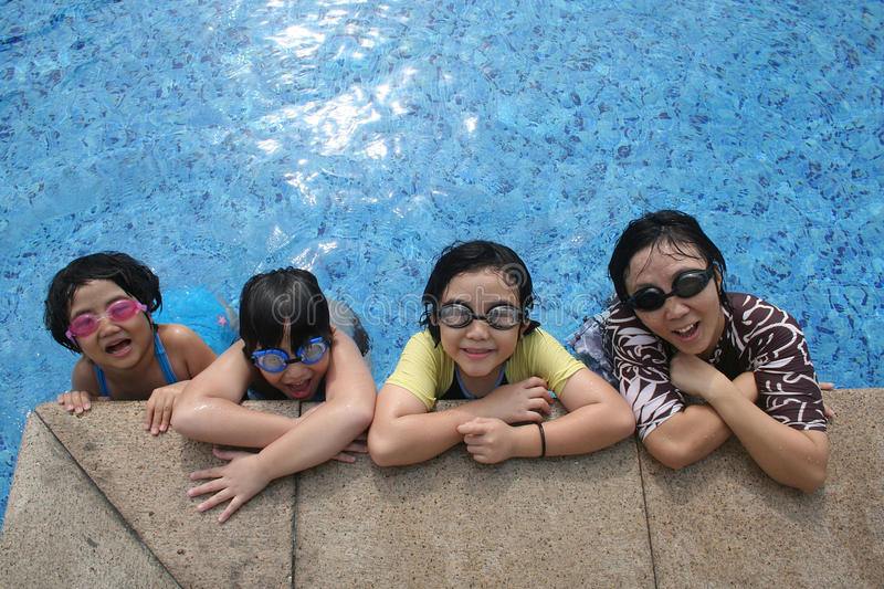 Mother And Kids In The Pool Royalty Free Stock Photography