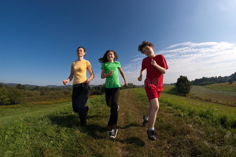Download Mother with kids running stock image. Image of child - 10781055