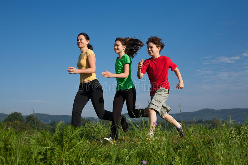 Mother with kids running stock image