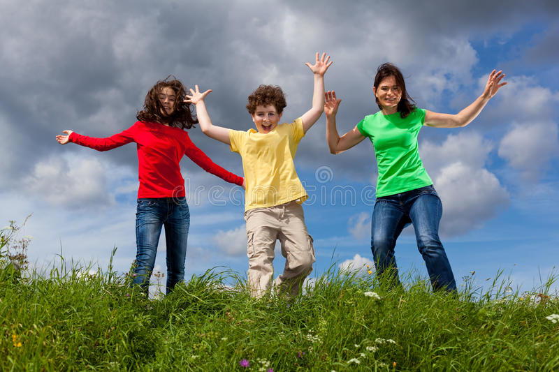 Download Mother with kids running stock image. Image of horizontal - 15962345