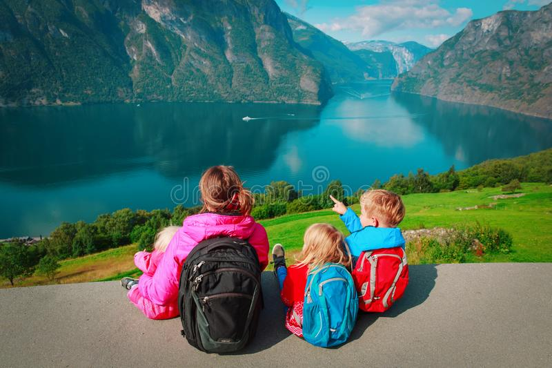 Mother with kids travel in nature, looking at view, Norway. Europe stock photography