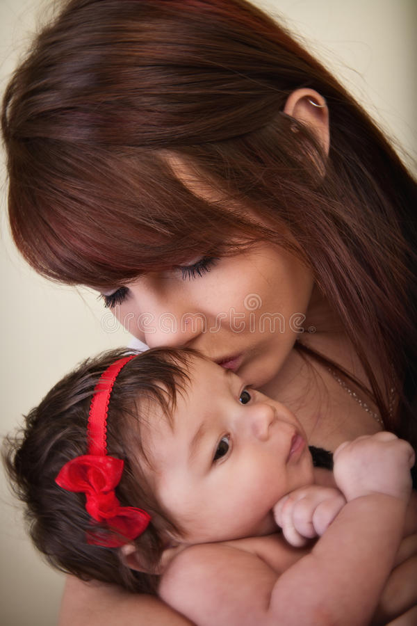Mother Kisses Baby stock photography
