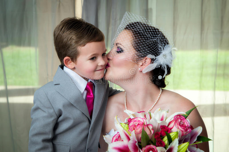 Mother Kisses Son On Her Wedding Day Stock Photo