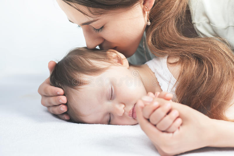 Mother kissing a baby. Care concept royalty free stock photo