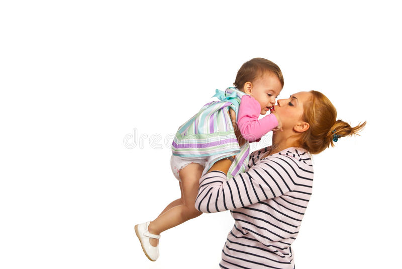 Mother kissing her daughter royalty free stock photography