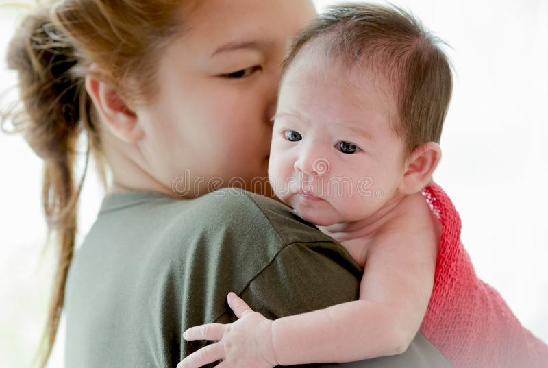 Mother kissing her new born baby girl royalty free stock image